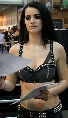 Paige at WWE Axxess 2014.- n English professional wrestler and actress. She is signed to WWE, where she performs under the ring name Paige. She is a two-time WWE Divas Champion. She has the longest reign (at 308 days),as well as being the inaugural NXT Women's Champion in WWE's developmental branch, NXT – at one point, she held both championships concurrently.  At the age of 13, Bevis made her debut in 2005 in the World Association of Wrestling, a promotion run by her family, under the ring…
