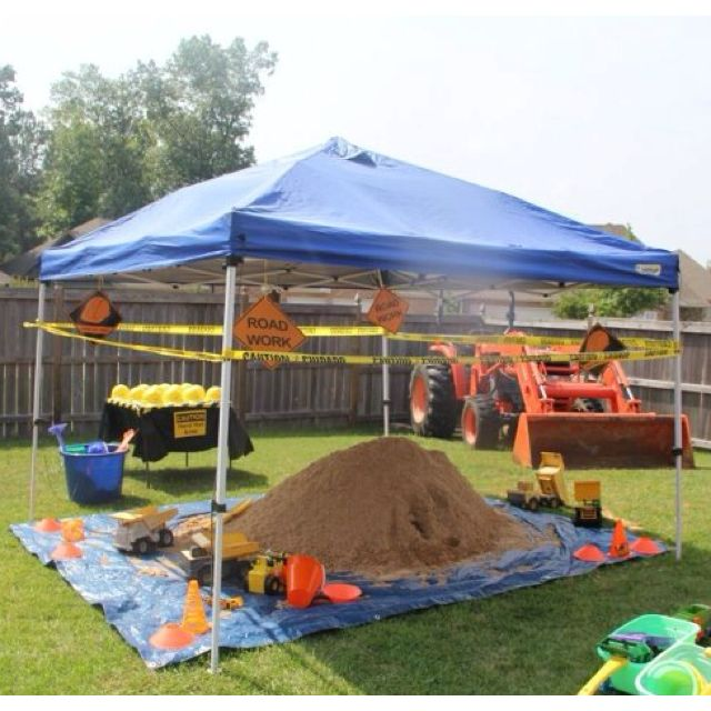 construction site/ dirt party- Whoa...that would be a bit messy...but Kris could bring his tarp...and we have bags of sand...the boys could play in...with shovels...and we could hide toys in it...for the kids to find. That could be fun in the back yard. :-)