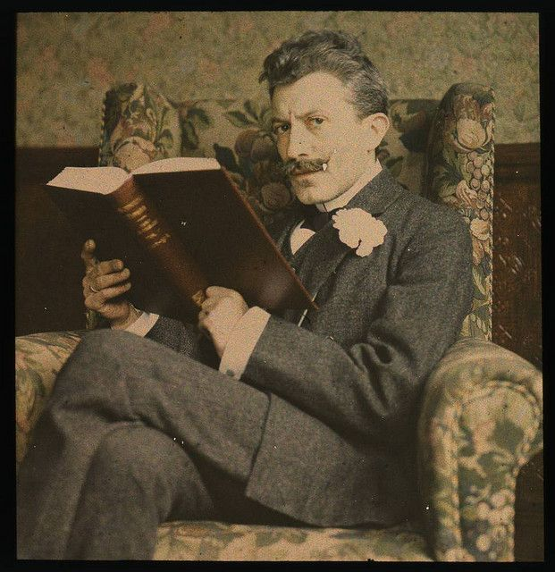 Man with book sitting in chair by George Eastman House, via Flickr
