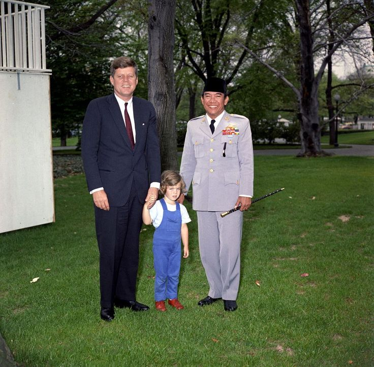 President John F. Kennedy stands with his daughter Caroline Kennedy and President of Indonesia Ahmed Sukarno on the South Lawn, White House, Washington, D.C.