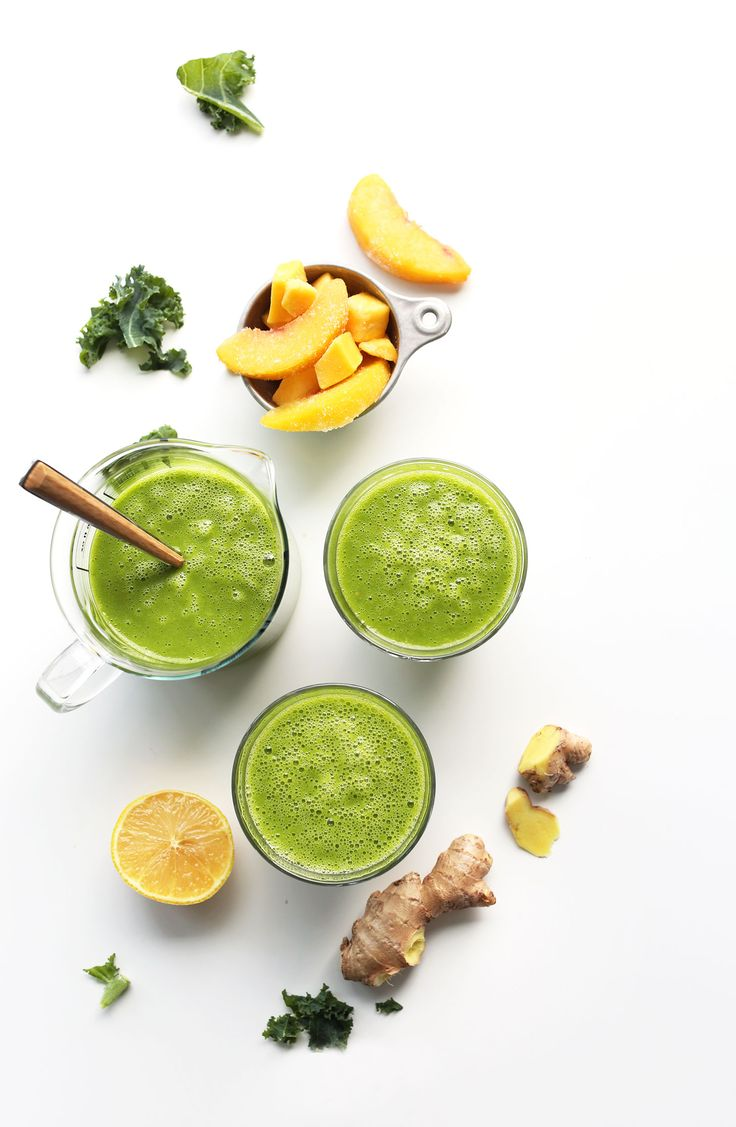 A healthy green smoothie recipe with ginger, lemon, peach, mango, and kale!