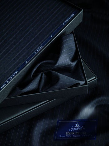 Scabal Expression Super 200's blended with Vicuna and Chinchilla  one of the finest suiting cloths. Fine looking, beautifully soft to the touch  with a natural drape that keeps well during use appeals through its elegance and luxurious softness of rare fibres.Traditional weaving techniques Ultra fine 13-micron Super 200's Merino wool forms the basis of this new cloth advanced spinning technology blending it with Vicuna and Chinchilla fibres highly valued for their rarity/ exceptional…