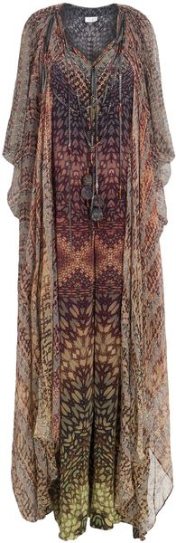 Camilla Green Round Neck Tourmaline Kaftan_    Camilla's Round Neck Tourmaline Kaftan conveys the bold and beautiful. The wide-open embellished neckline and colourful graphic print ooze sensuality. 100% Silk.     _   $918 at Boutique1