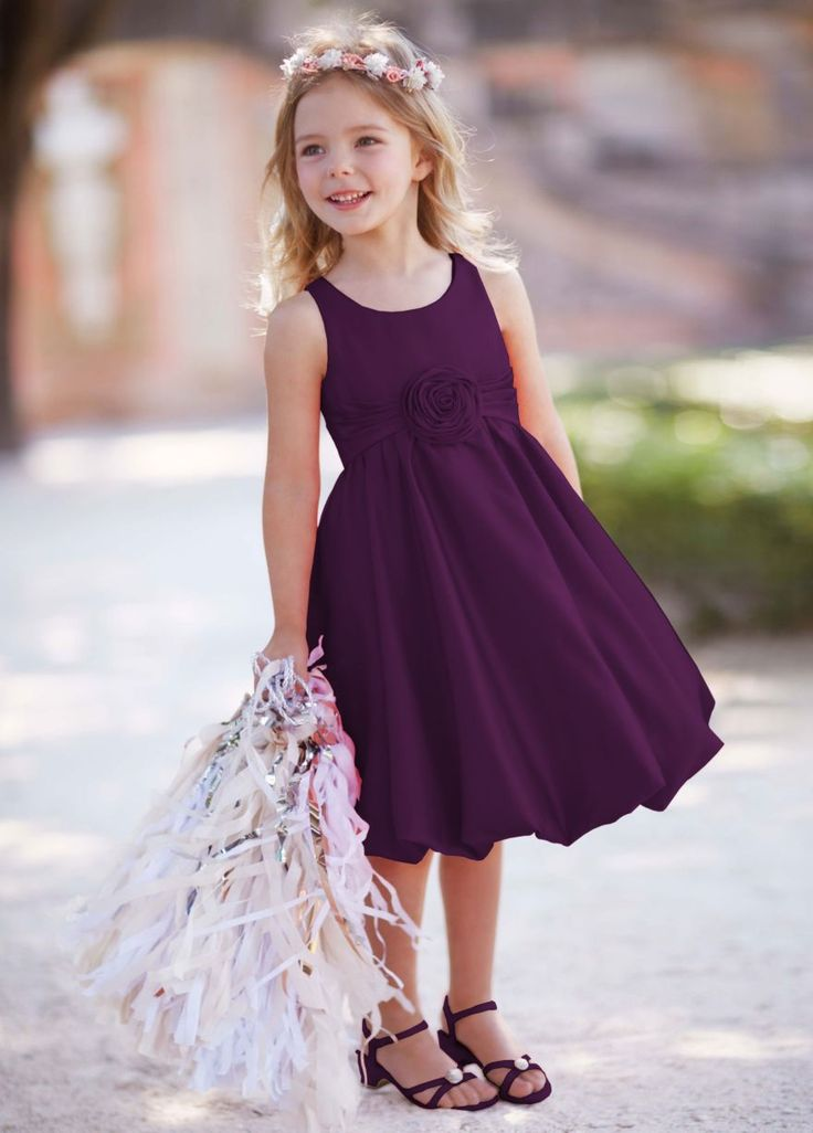 Flower girl dress - put them in the purple if bridesmaids are grey and maid of honor in yellow.