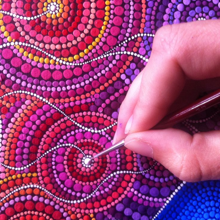 Elspeth McLean at work on her intricate pointillist dot paintings