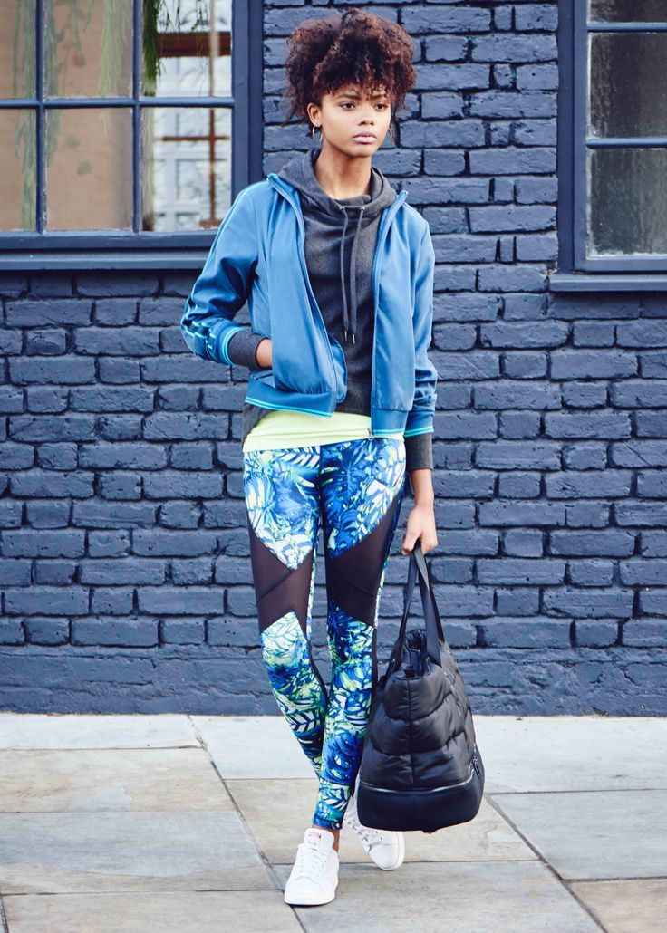 Going from barre to bar in reversible leggings. Take a walk on the wild side in tropical prints or reverse to black for easy chic styling.