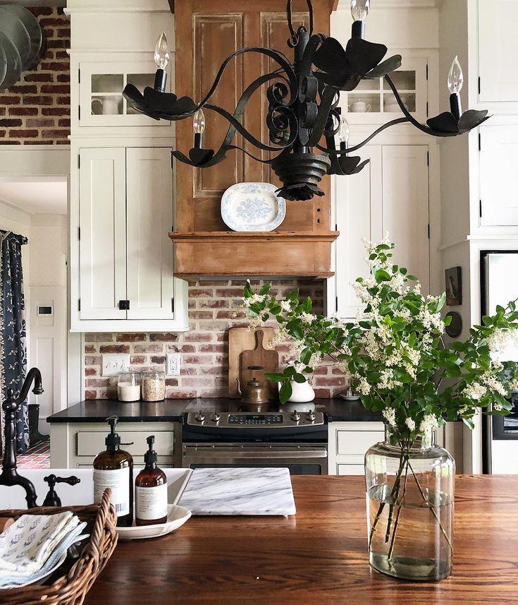 Gorgeous Farmhouse Kitchen With Wrought Iron Chandelier Brick