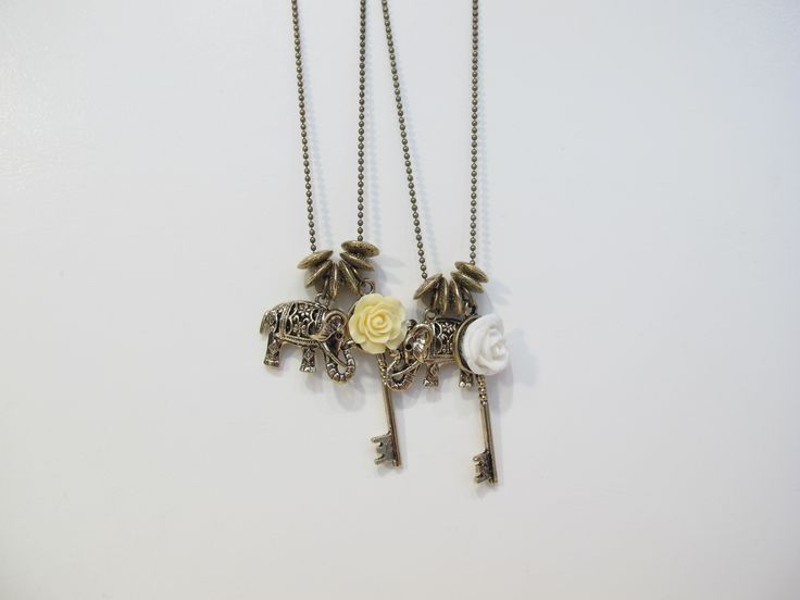 Elephant with rose and key necklace