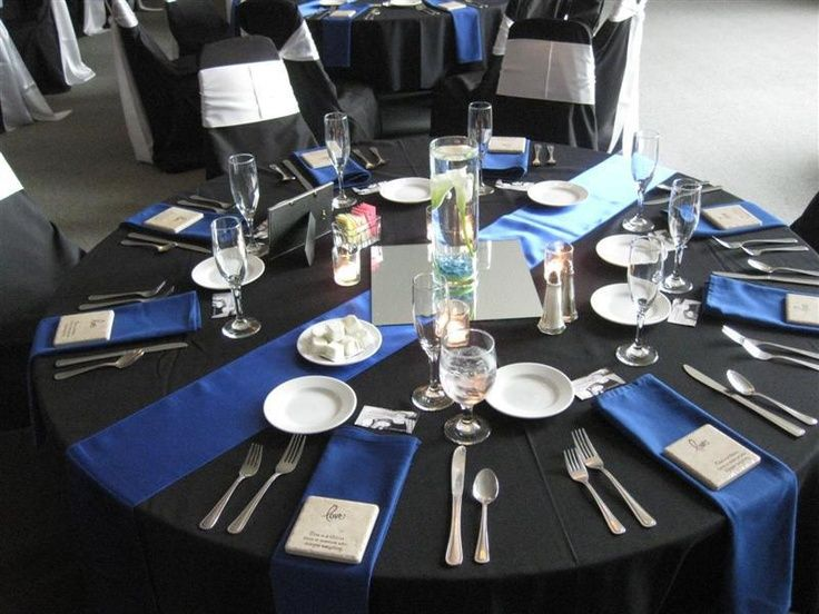 Beautiful Royal Blue Satin Table Runner And Napkins Accent The Black Table Linen,  Black Chair Covers, And White Chair Sashes
