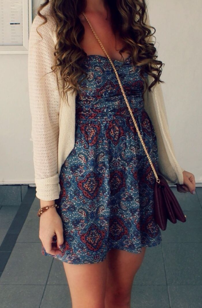 Such a cute dress and outfit - I love the length and silhouette of the skirt, and the neckline is modest and really pretty, and the dark print is also really pretty - looks great with this color knit cardigan over and the styling is great - really well put together