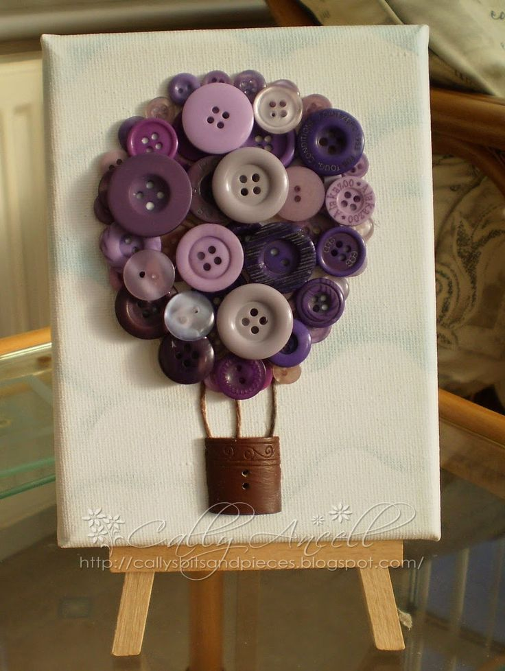 Balloon made from buttons on a mini canvas. Clouds on the canvas have been made with a mask and chalk.