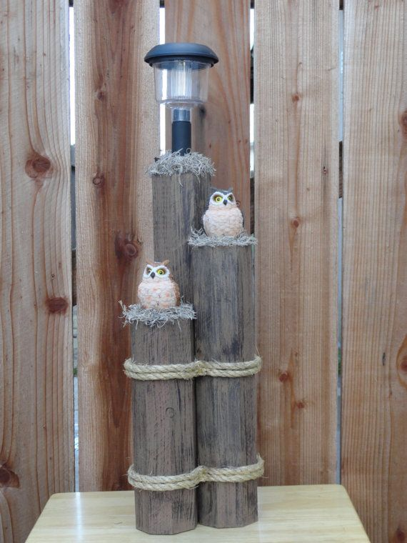 Wooden post decor with solar light and owls