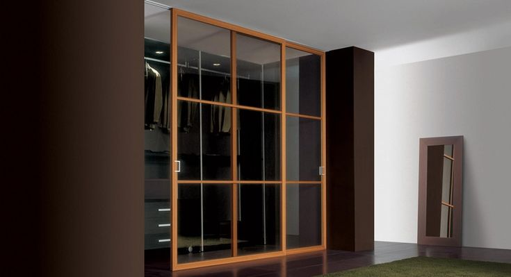 Mood XL    design Cavana.Santambrogio    System characterised by a large frame, rather suitable for wood finishings. All the range is supplied with the new Res' lock and sliding systems, such as the new reduced rail that can be fitted into the ceiling.