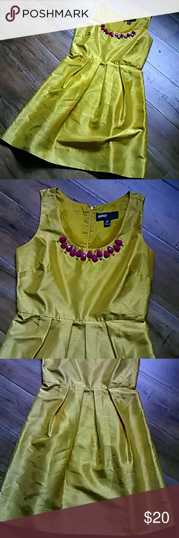 Miss Sixty dress size 6 Gorgeous yellow dress with fuschia embellishments at the neck. Just in time for Easter spring. This dress is 36 inches long. It is in good condition. This dress is 100% polyester. Miss Sixty Dresses Midi