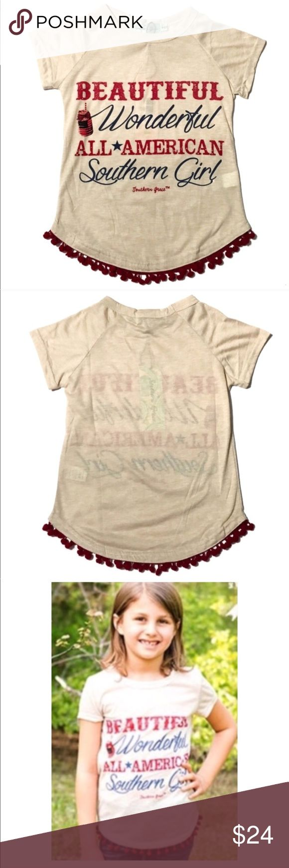 Beautiful Wonderful All-American Southern Girl Tee Beautiful, Wonderful, All-American Southern Girl. Cute tee shirt with red Pom Poms at hem. Patriotic t-shirt from Southern Grace. ‼️Size listed as 7 is actually size 6/8 according to the tag. 👠   🔺Questions? Please ask.  🔺I want your Poshmark experience to be easy & enjoyable. 🔺Thank you for shopping at Posh Mishmosh. Eb SQ Southern Grace Shirts & Tops Tees - Short Sleeve