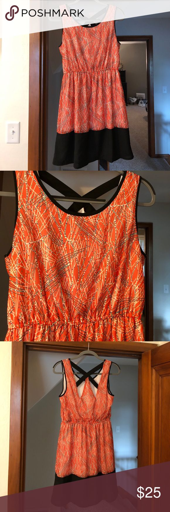 Summer dress with cool cutouts in back Bought from a boutique on Hilton Head Island. Tagged Francesca's because of the similar style & quality. Pretty orange with black accents. Really fun cutouts in back. Haven't worn in too long so I am looking to sell, nothing wrong with it. Same/ext day shipping 📦 make me an offer Francesca's Collections Dresses Mini