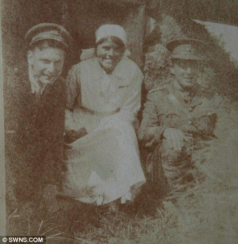 On the front line: Nurse 'Kitty' Card in a trench during WWI with a couple of soldiers  Read more: http://www.dailymail.co.uk/news/article-1365088/Diary-Battle-Somme-Florence-Nightingale-nurse-auction.