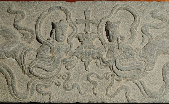 "Angels with Nestorian style cross on lotus, Quanzhou China. Nestorianism reached China in the 7th Century CE from the Sassanian Persian Empire via the Silk Road. The religion was permitted by imperial court for diffusion as early as AD 638 and was first called ""the Persian Religion (or Doctrine)"" (Bosijiao) because of its long connection with Sassanian Persia."
