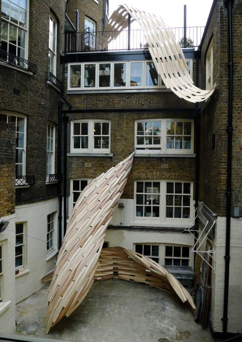 Led by artist Lawrence Lek, designer Onur Ozkaya and architect Jesse Randzio, the students conceived of the design, and constructed the oversized leaf-like pieces, which hang from their fourth floor roof, themselves. The three twisting sculptures contort their way down the Architectural Association building in Bedford Square. With a restriction lifted on building skyscrapers, the project focuses on London's inevitable growth, which the students feel will lead inward and skyward.