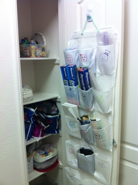 Shoe caddy inside the pantry door - holds all of my ziploc bags, tin foil, napkins, straws.  I cleared out a whole shelf of space!