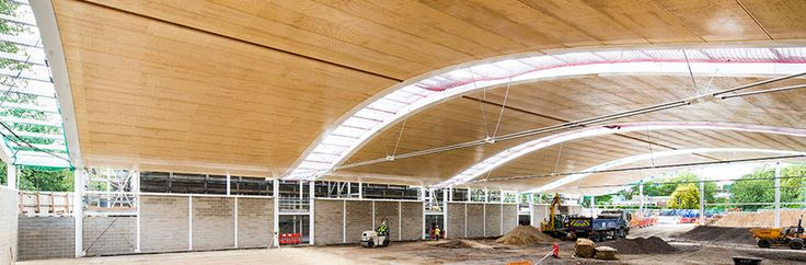 The Kerto wood elements constitute the vaulted roof construction are 12.9 meters long and have a total height of 645mm and maximum width of 1200 millimeters. To accommodate the curve of the structure four different widths were determined 550 mm, 600 mm 700 mm, and 1200 mm, totaling 140 prefabricated wood elements. Image by Metsä Wood UK