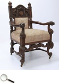 A mahogany Coronation Durbar chair, the cresting rail carved with heraldic devices and lettering DELHI CRI 1911, exquisite coronet finials, the serpentine arms with lions head terminals.     30 in L x 25 in B x 44 in H