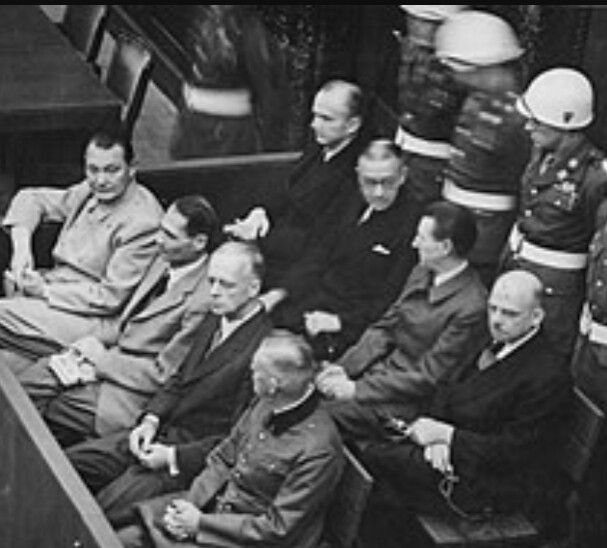 An image of the Nuremberg Trials. Recognizable, Hermann Goering, Rudolf Hess, Joachim von Ribbentrop, Wilhelm Keitel & Fritz Sauckel (behind).