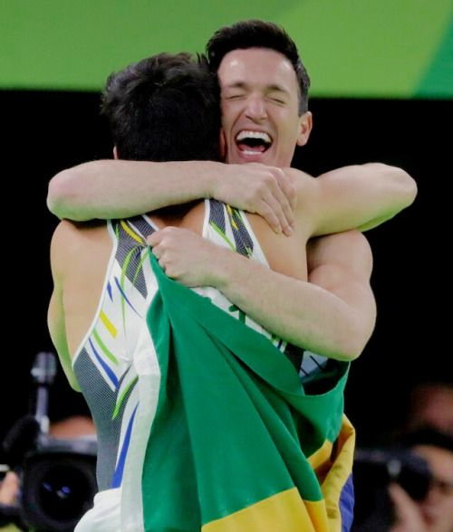 """brasildaily:  """" Diego Hypolito and Arthur Mariano of Brazil celebrate winning silver and bronze respectively in the Men's Floor Exercise Final on Day 9 of the gm2016 Olympic Games at the Rio Olympic Arena on August 14, 2016 in Rio de Janeiro,..."""