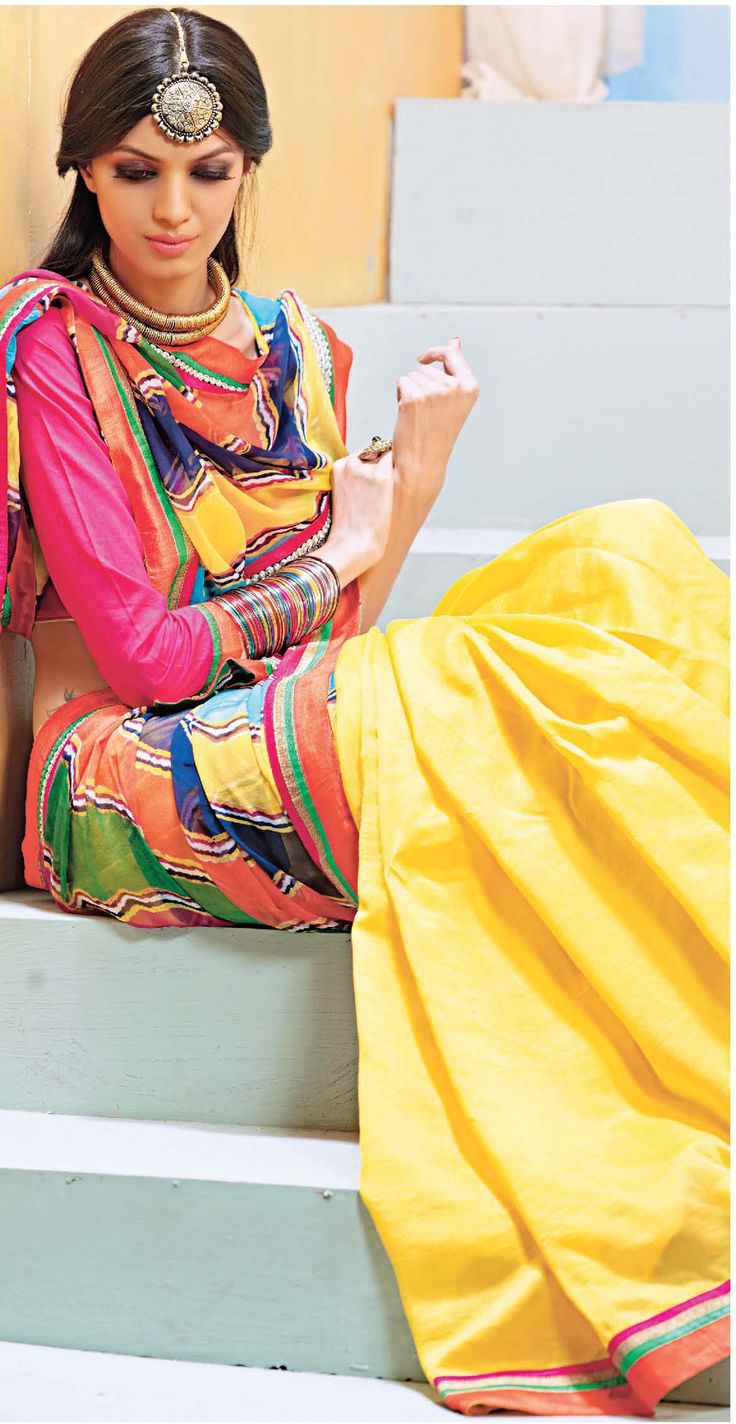 Fabulous yellow Cotton Saree with pink blouse that makes perfect combination