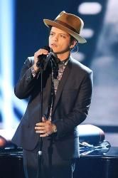 Hey, is this guy from... you know...? Bcz he SINGS like he's from OUTTA THIS WORLD!! ... Bruno Mars Lands First U.S Number One Album