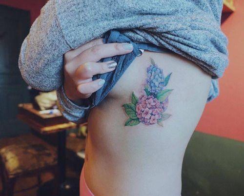 Illustrative style hydrangea tattoo on the left side. Tattoo...