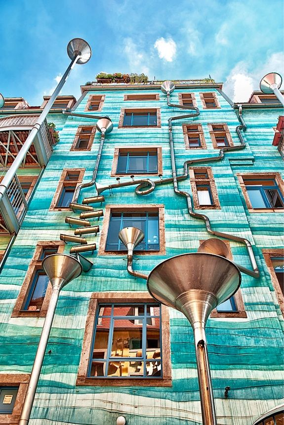 When it rains, water is channeled down the front of the building in a way that creates melodic notes as it goes. It sounds almost like this cool piece of architecture is singing! They took their inspiration from a Rube Goldberg machine, a contraption designed to perform a simple task in an comically over-engineered fashion.