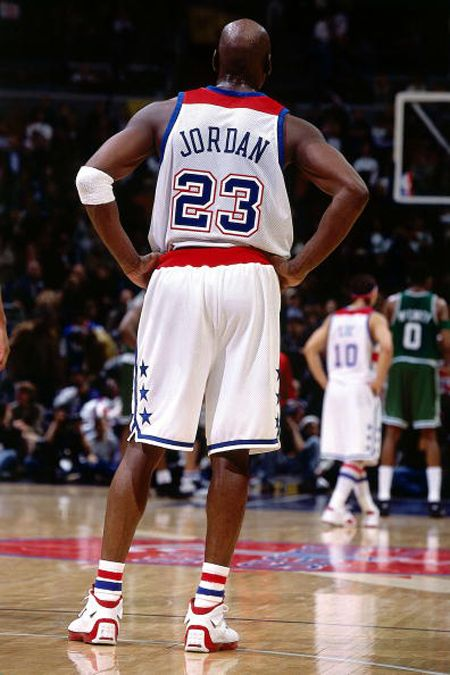 WASHINGTON - APRIL 9: Michael Jordan #23 of the Washington Wizards waits downcourt during his final NBA game against the Boston Celtics at the MCI Center on April 9, 2003 in Washington D.C. The Celtics won 87-83. The Wizards wore the red and white horizontally striped uniforms of the 1978 Washington Bullets. NOTE TO USER: User expressly acknowledges and agrees that, by downloading and/or using this Photograph, User is consenting to the terms and conditions of the Getty Images License…