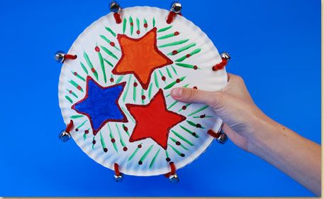 """Paper Plate #Crafts: Jingling Tambourine. """"Sew"""" together two paper plates using fuzzy sticks and jingle bells to make a jingling homemade tambourine!"""
