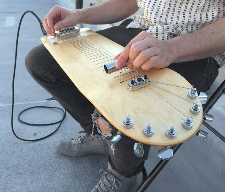 A NY design and architecture duo turn a wooden skateboard deck into a laptop steel guitar