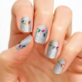 Christmas Twinkle Get your glow on with the glittering holiday light design of Christmas Twinkle!  Glitter finish. Each set includes 16 double-ended nail polish strips.   Price: $13.00  #winternailart #holidaynailart