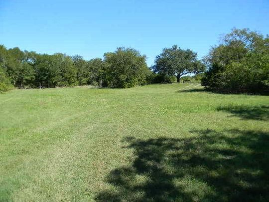 Tejas Park sits on the south side of Georgetown Lake in the Hill Country of Texas, about 25 miles north of Austin.   Tejas park features plenty of large, grassy open areas, offering lots of room for running around and enjoying the scenic Texas countryside.