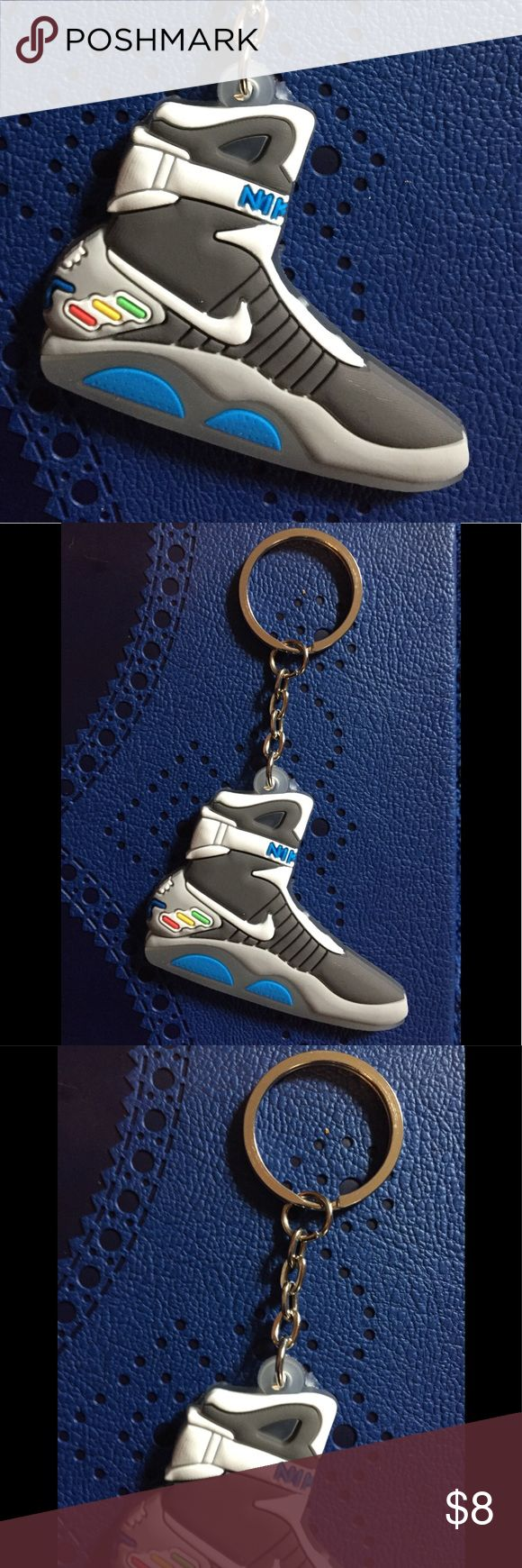 """Cult Of Personality Back To The Future II Keychain Cult Of Personality Back To The Future II Keychain  This Keychain Is Made Of PVC In The Design Of Marty's Shoes From Back To The Future II  Silver Tone Hardware  Measures 3.5"""" Long  x 2.5"""" Wide NWT  Bundle Two Or More Items From My Shop & Save 25% Automatically! Plus You'll Save A Bunch On Shipping! Emporiama's Cult Of Personality Accessories Key & Card Holders"""