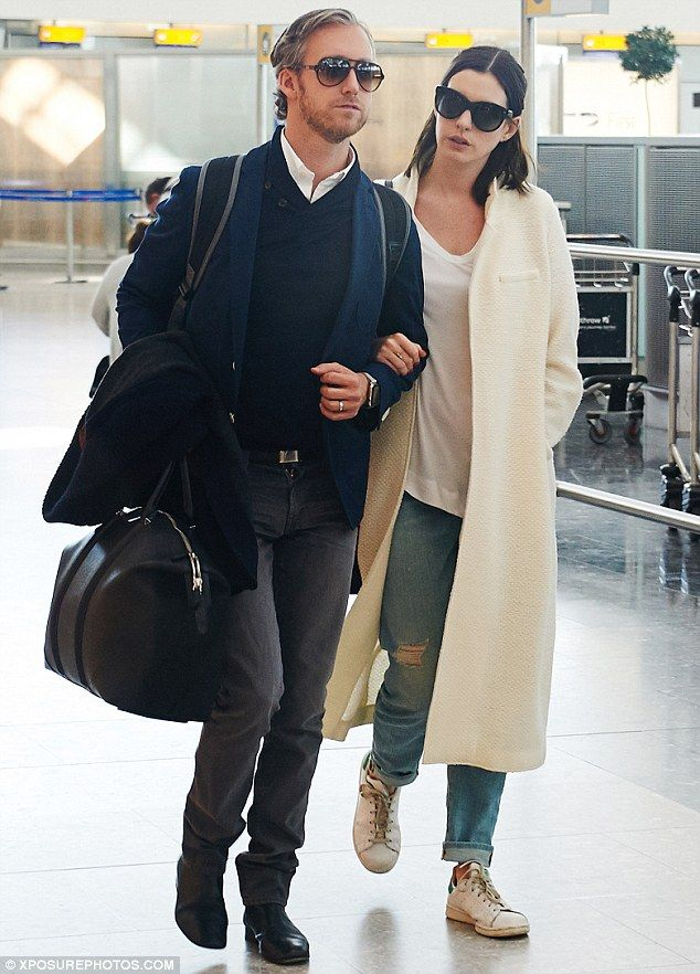 And relax! Anne Hathaway, 32, was happy and relaxed as she and her 34-year-old husband Adam Shulman strolled arm-in-arm through Heathrow airport as they headed back to the US on Wednesday