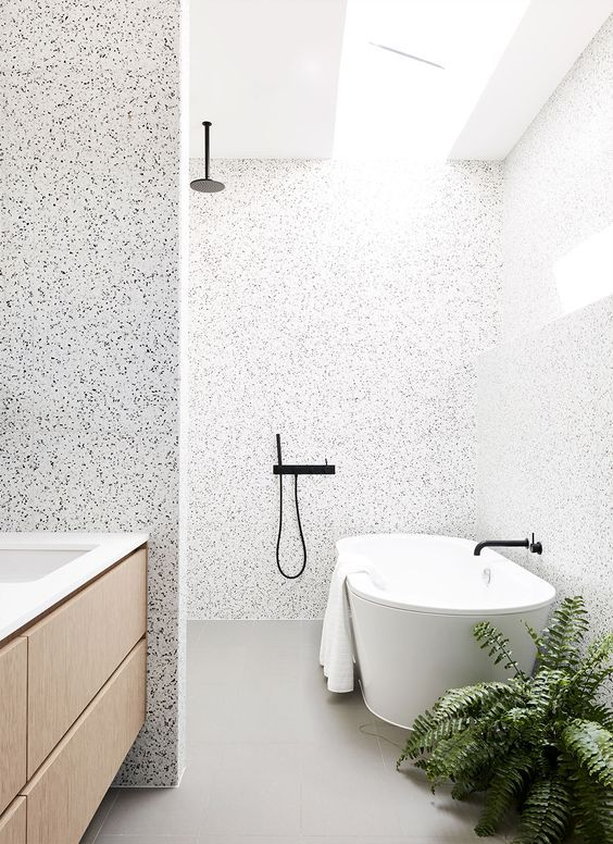 lighter terrazzo in the shower and bathtub zone and darker in the sink zone