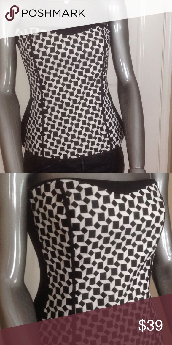 WHBM Strapless Top Lined top with non-slip border along the top to keep in place.  Geometric pattern on front, black back.  Tapered at waist for a very flattering fit.  No straps, but it does have loops sewn in to connect straps if you want to add. White House Black Market Tops