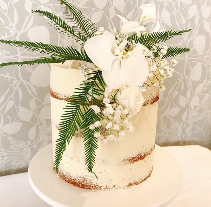 Naked wedding cake with white phalaenopsis orchid, baby's breath and ferns by Bells Dolce