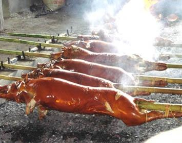 Lechon: Anthony Bourdain hailed the Filipino roasted pig as the Best Roasted Pig Ever. I agree!