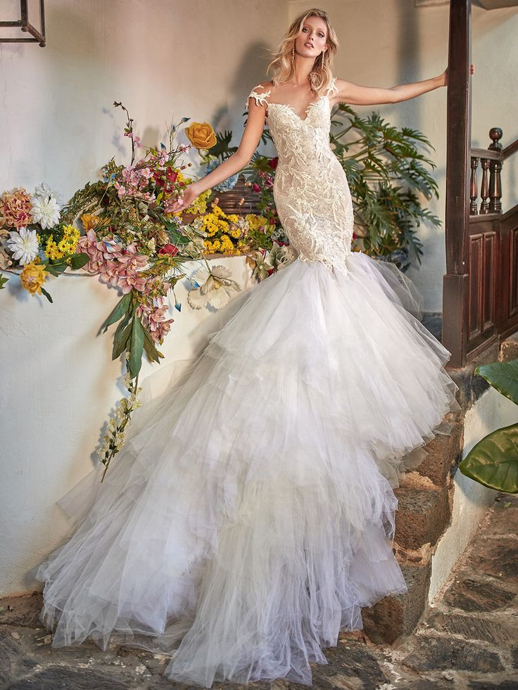 We know that you love a low-back trumpet style silhouette, so here is #Zenia from the #FlorenceByNight collection - its French lace mermaid fit and flare dramatic gown really is exquisite.   It features a low illusion back embroidered with large scale appliques and a two-toned handkerchief skirt, creating signature Galia Lahav style dress. The back is accentuated with handmade silk flowers.