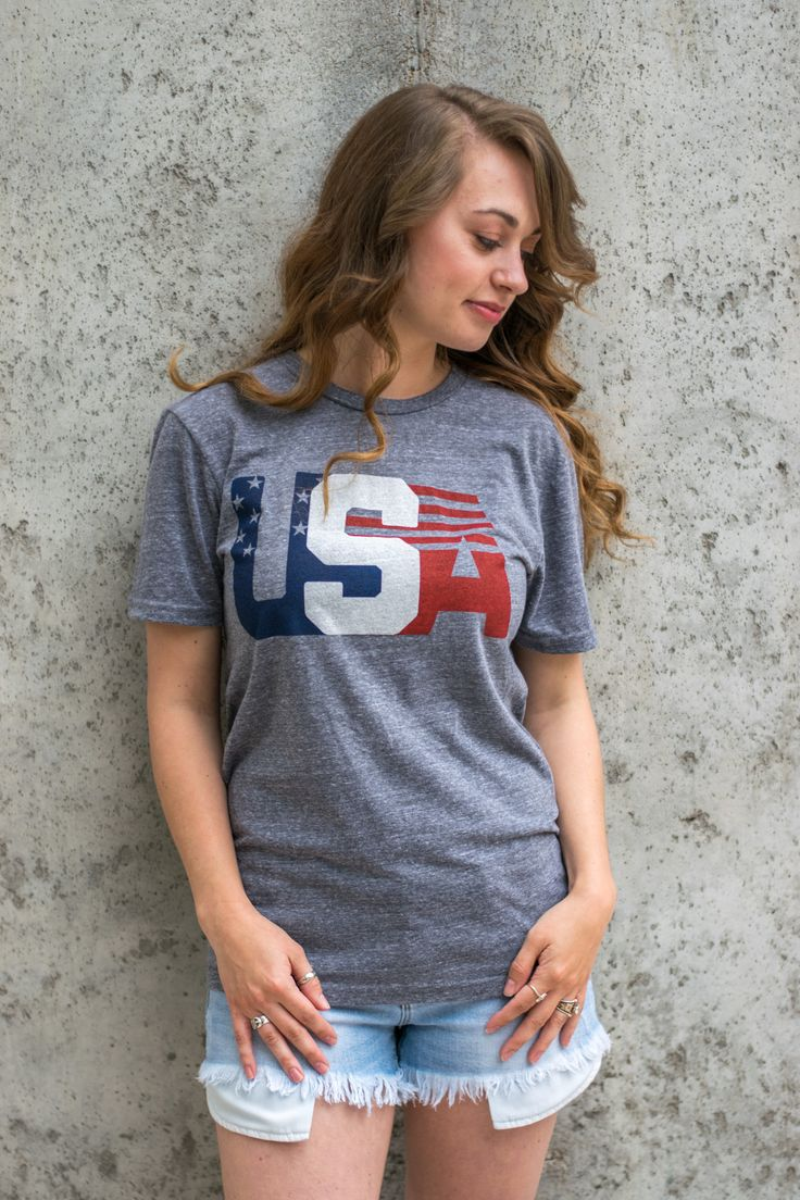USA Olympic unisex t-shirt. This retro inspired super soft t-shirt is not only trendy but it's unisex design and fit is great for both guys and girls! 50% polyester 37% cotton 13% rayon. Girl model is