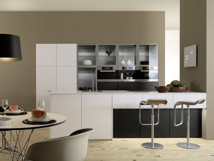 Interior, Nice Kitchen Interior Design With Modern White Kitchen Island With Bar Counter Stainless Steel Swivel Bar Stools White Kitchen Cabinet Wall Kitchen Cabinet With Glass Doors Built In Double Oven Light Laminate Wood Flooring: Perfect and Ideal Kitchen Interior Design Ideas