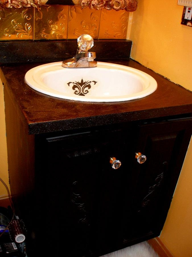Use a textured paint product on vanity top to cover up for Painting laminate bathroom vanity