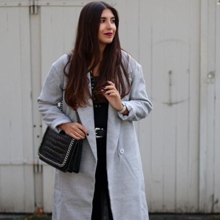 grey coat. by Leticia Neidl