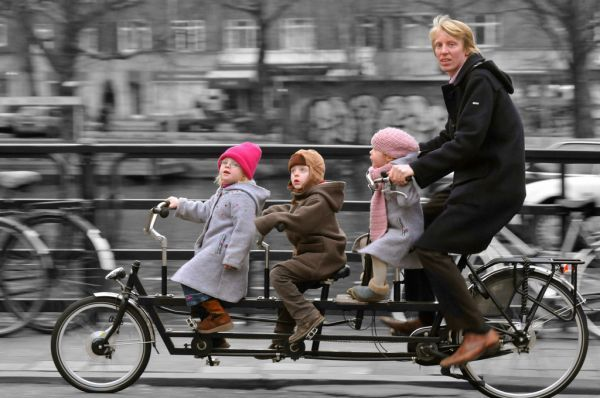 """Taking the Family on a Bike Ride"" Through Amsterdam may mean something different than what you're use to."