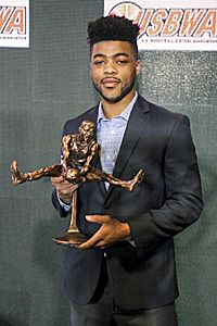Kansas Jayhawk Frank Mason III the 2017 winner of the USBWA (US Basketball Writers Assoc.) Oscar Robertson Trophy. Frank is Sixth on the Kansas all-time scoring list with 1,885 points, sixth in assists with 576 and eighth in 3-point field goals with 185. No Jayhawk player in KU history ranked sixth or higher in both points and assists. Mason averaged 20.9 points and 5.1 assists this season while shooting 48.7 percent from 3-point range.